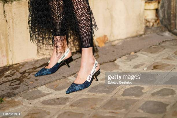 d75dc24a70d0 A guest wears Dior J Adior shoes outside Dior during Paris Fashion Week  Womenswear Fall