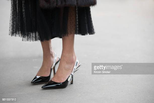 Guest wears Dior shoes day 2 of Paris Womens Fashion Week Spring/Summer 2018, on February 27, 2018 in London, England.