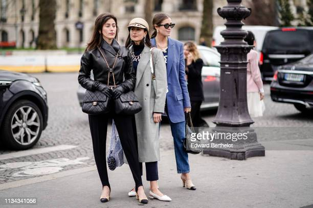 A guest wears earrings a black leather jacket two black Chanel bags black pants beige and black Chanel shoes a guest wears a beige Chanel cap Chanel...