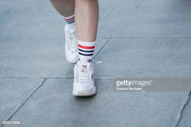 A guest wears Fila sneakers during London Fashion Week Men's January 2018 at on January 7 2018 in London England