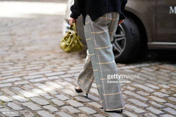 A guest wears gingham gray pants during London Fashion Week September 2017 on September 16 2017 in London England