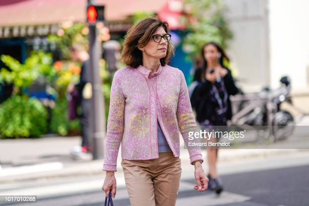 Guest wears glasses, a pink glitter jacket, outside Wooyoungmi, during Paris Fashion Week - Menswear Spring-Summer 2019, on June 23, 2018 in Paris,...