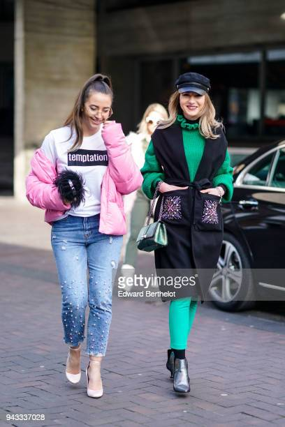 A guest wears glasses a white tshirt a pink puffer coat blue jeans with pearls white shoes a guest wears a hat a green wool pull over a black...
