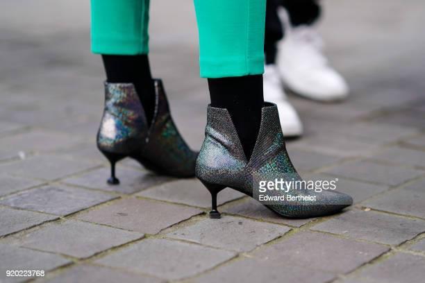 A guest wears glitter shoes during London Fashion Week February 2018 on February 18 2018 in London England