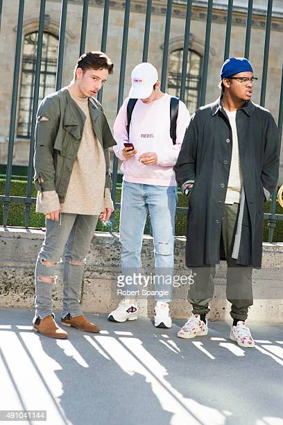 Guest wears green Nobless Couture military jacket, guest wears pink Zack BYZ sweatshirt and white Raf Simons sneakers, Guest wears black Nobless...