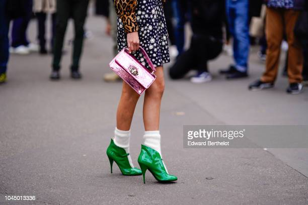 Guest wears green shoes, white socks, a pink shiny bag, outside Miu Miu, during Paris Fashion Week Womenswear Spring/Summer 2019 on October 2, 2018...