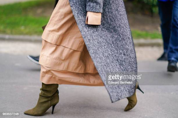 A guest wears green suede boots pink salmon ruffled dress a gray coat during Paris Fashion Week Womenswear Fall/Winter 2018/2019 on February 28 2018...
