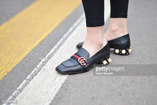 A guest wears Gucci loafers before the Fendi show during the Milan Fashion Week Fall/Winter 2016/17 on February 25 2016 in Milan Italy
