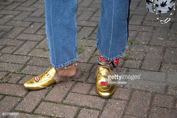 A guest wears Gucci shoes on day 3 of London Womens Fashion Week Spring/Summer 2017 on September 18 2016 in London England