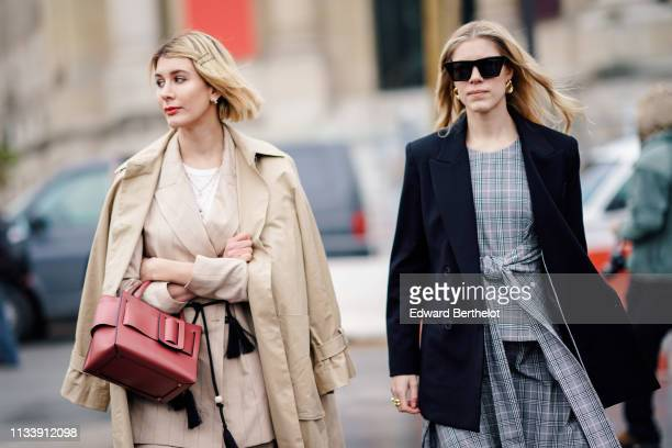 Guest wears hairpins, a beige trench coat, a beige jacket, a red bag ; a guest wears sunglasses, earrings, a navy blue jacket, a grey checkered...