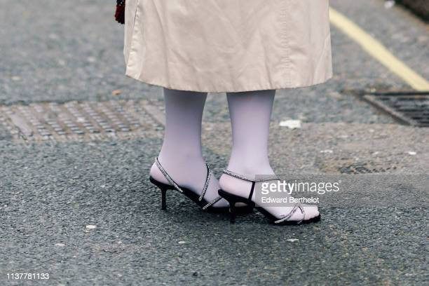 A guest wears heeled sandals with rhinestone embellished straps during London Fashion Week February 2019 on February 16 2019 in London England