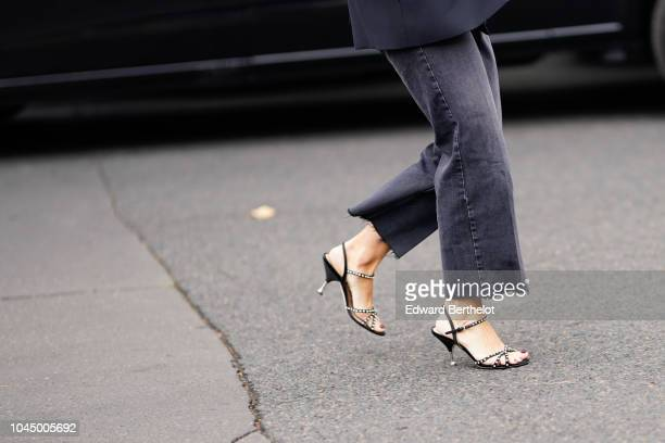 A guest wears heels shoes outside Miu Miu during Paris Fashion Week Womenswear Spring/Summer 2019 on October 2 2018 in Paris France