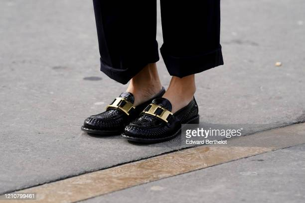 Guest wears leather shoes, outside Chanel, during Paris Fashion Week - Womenswear Fall/Winter 2020/2021 on March 03, 2020 in Paris, France.