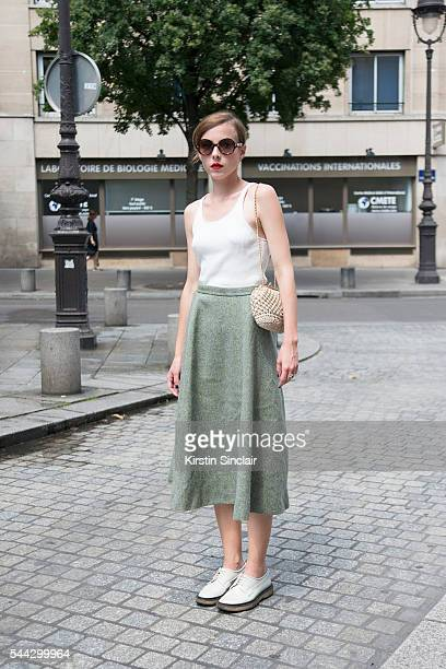 Guest wears Lemaine for Uniqlo top, Adieu shoes and vintage skirt and bag on day 2 of Paris Collections: Men on June 23, 2016 in Paris, France. Guest