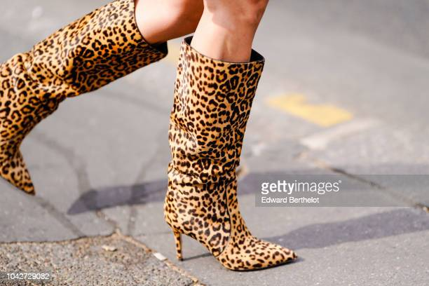 A guest wears leopard print boots outside Issey Miyake during Paris Fashion Week Womenswear Spring/Summer 2019 on September 28 2018 in Paris France