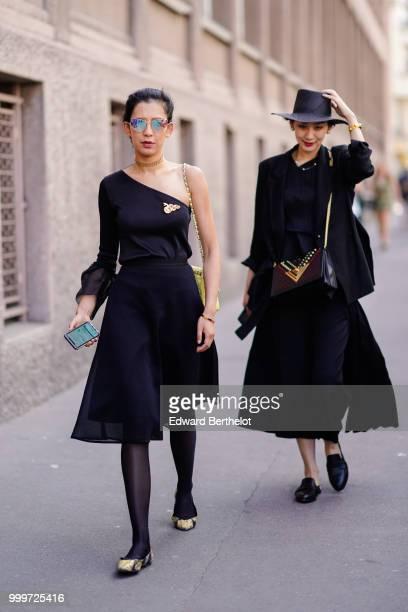 A guest wears mirror sunglasses an offshoulder dress outside Wooyoungmi during Paris Fashion Week Menswear SpringSummer 2019 on June 23 2018 in Paris...