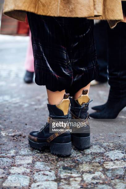 A guest wears monogrammed Louis Vuitton boot sn January 26 2018 in Oslo Norway