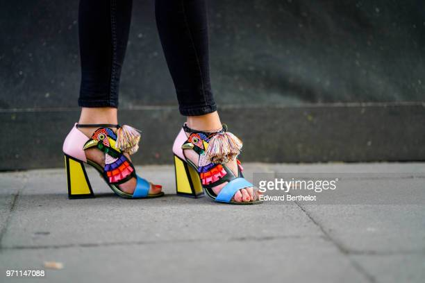 A guest wears multicolor shoes during London Fashion Week Men's June 2018 on June 10 2018 in London England
