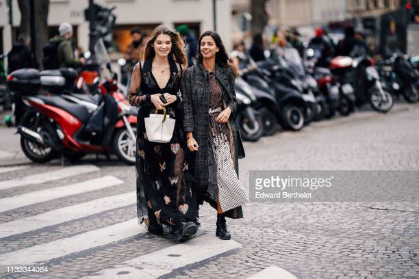 A guest wears necklaces a lowcut embroidered transparent black muslin dress a white bucket handbag a guest wears a grey tweed coat a brown ruffled...