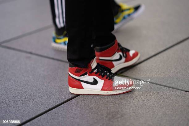A guest wears Nike red sneakers shoes outside Off White during Paris Fashion Week Menswear Fall Winter 20182019 on January 17 2018 in Paris France