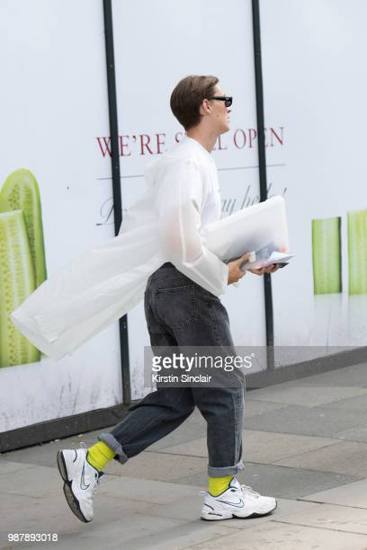 A guest wears Nike trainers during London Fashion Week Men's on June 10 2018 in London England