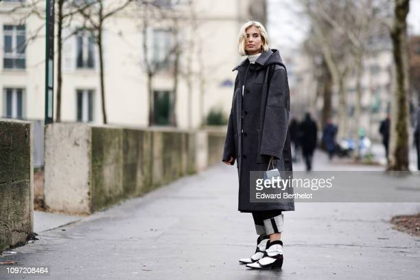 Guest wears, outside Jacquemus, during Paris Fashion Week - Menswear F/W 2019-2020, on January 20, 2019 in Paris, France.