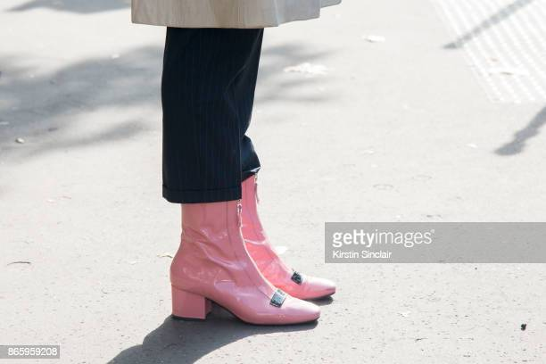 A guest wears pink patent boots day 2 of Paris Womens Fashion Week Spring/Summer 2018 on September 27 2017 in London England
