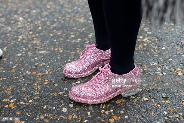 A guest wears pink sparkly shoes on day 5 of London Collections Women on February 18 2014 in London England