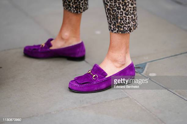 A guest wears purple shoes during London Fashion Week February 2019 on February 19 2019 in London England