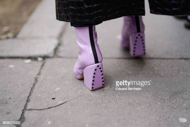 A guest wears purple shoes during Paris Fashion Week Womenswear Fall/Winter 2018/2019 on March 3 2018 in Paris France