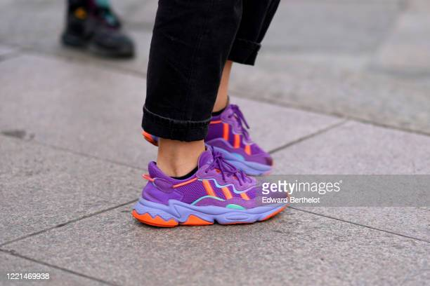 Guest wears purple sneakers shoes, during Milan Fashion Week Fall/Winter 2020-2021, on February 19, 2020 in Milan, Italy.