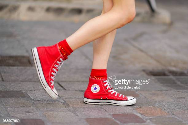 A guest wears red Converse sneakers shoes outside Christian Dada during Paris Fashion Week Menswear SpringSummer 2019 on June 24 2018 in Paris France
