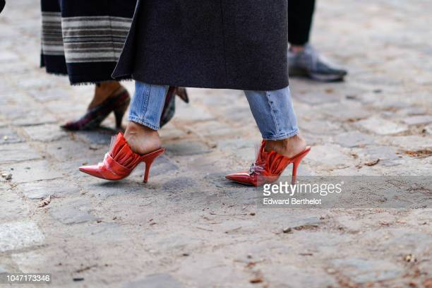 Guest wears red ruffled shoes with heels, outside Akris, during Paris Fashion Week Womenswear Spring/Summer 2019, on September 30, 2018 in Paris,...