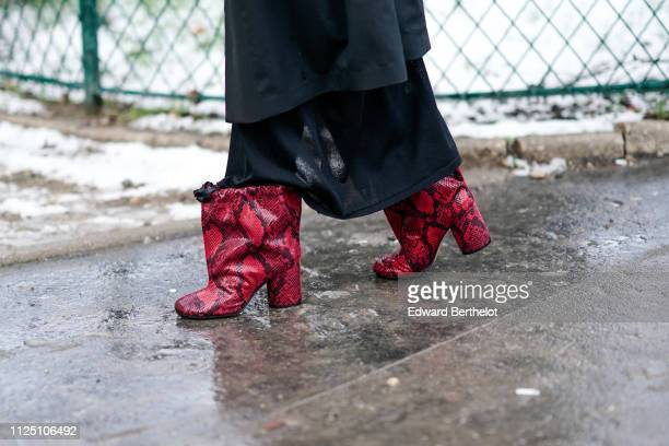 A guest wears red snake print leather shoes outside Alexandre Vauthier during Paris Fashion Week Haute Couture Spring Summer 2020 on January 22 2019...