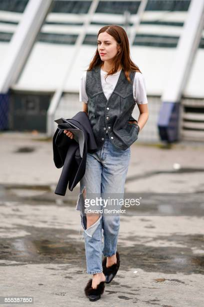 A guest wears ripped jeans outside Ann Demeulemeester during Paris Fashion Week Womenswear Spring/Summer 2018 on September 28 2017 in Paris France
