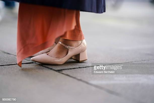 A guest wears salmon colored shoes during London Fashion Week February 2018 on February 16 2018 in London England