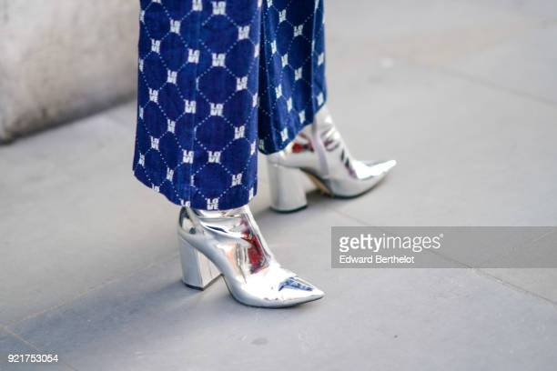A guest wears silver shoes during London Fashion Week February 2018 on February 16 2018 in London England