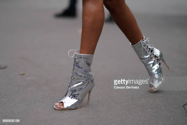 A guest wears silver shoes outside Valentin Yudashkin during Paris Fashion Week Womenswear Spring/Summer 2018 on October 2 2017 in Paris France