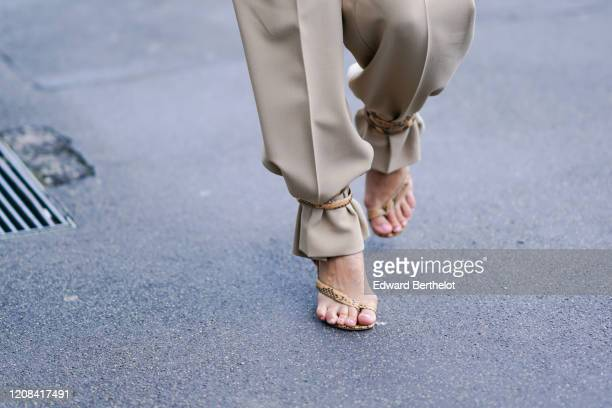 A guest wears snake pattern printed shoes outside BOSS during Milan Fashion Week Fall/Winter 20202021 on February 23 2020 in Milan Italy