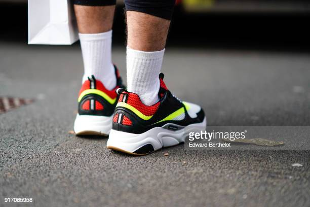 A guest wears sneakers and white socks during London Fashion Week Men's January 2018 at on January 6 2018 in London England
