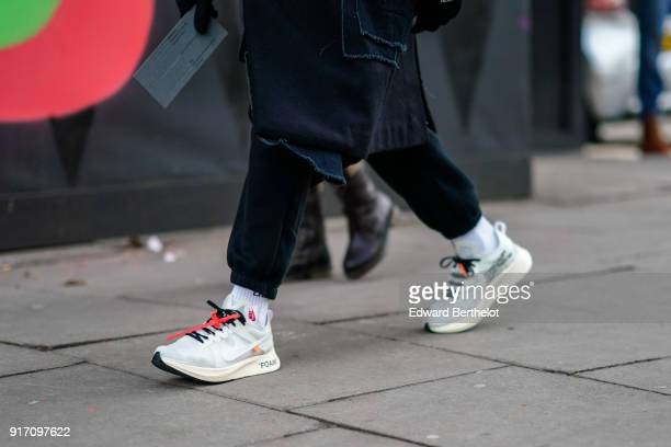A guest wears sneakers during London Fashion Week Men's January 2018 at on January 6 2018 in London England