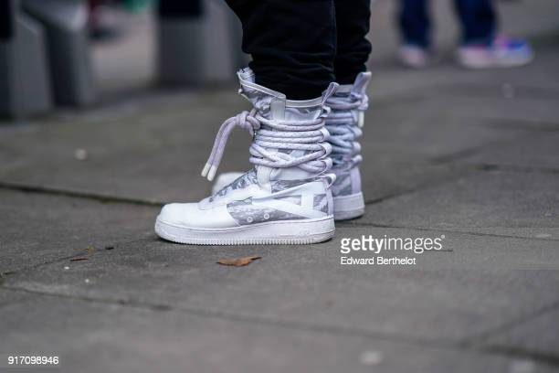 A guest wears sneakers shoes during London Fashion Week Men's January 2018 at on January 6 2018 in London England