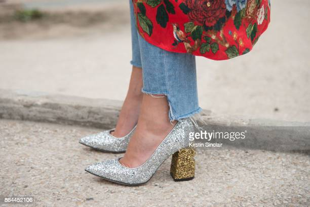 A guest wears sparkly gold and silver wedge heeled shoes day 2 of Paris Womens Fashion Week Spring/Summer 2018 on September 27 2017 in London England