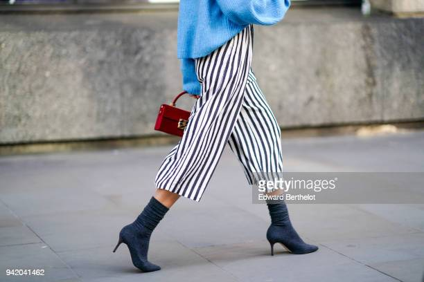 A guest wears striped cropped pants shoes during London Fashion Week February 2018 on February 16 2018 in London England