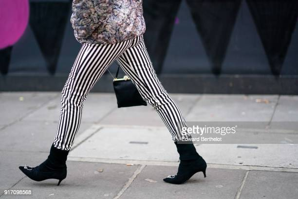 A guest wears striped pants black shoes during London Fashion Week Men's January 2018 at on January 6 2018 in London England