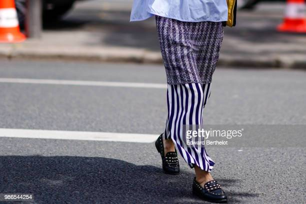 A guest wears striped skirt outside Lanvin during Paris Fashion Week Menswear SpringSummer 2019 on June 24 2018 in Paris France