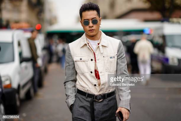 A guest wears sunglasses a beige and grey jacket a black belt grey pants outside Lanvin during Paris Fashion Week Womenswear Spring/Summer 2018 on...