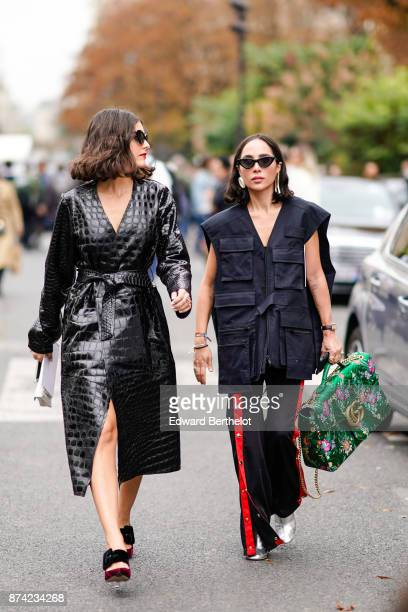 A guest wears sunglasses a black leather coat a guest wears sunglasses a sleeveless jacket sportswear pants with red stripes a large Gucci green bag...