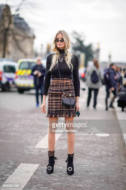 A guest wears sunglasses a black top a tweed multicolor skirt black shoes outside Chanel during Paris Fashion Week Womenswear Fall/Winter 2018/2019...