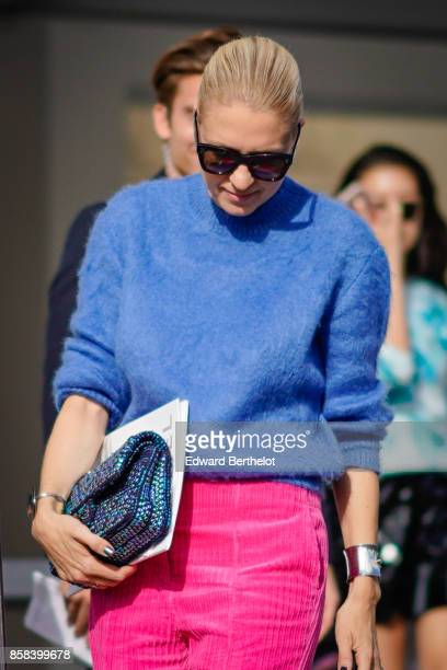 A guest wears sunglasses a blue pull over pink pants outside Chanel during Paris Fashion Week Womenswear Spring/Summer 2018 on October 3 2017 in...